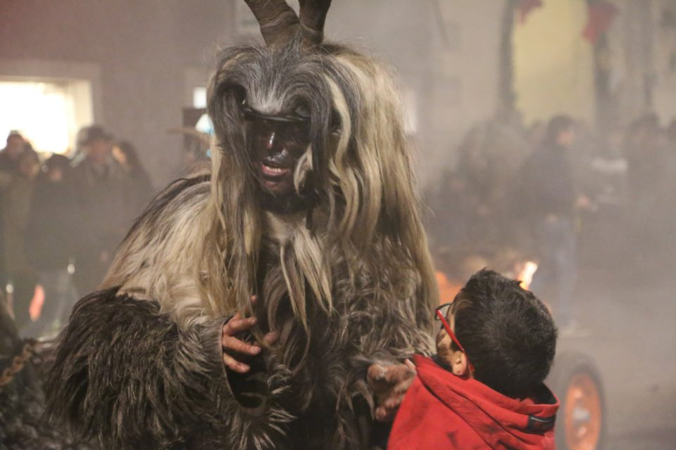 Krampus with a small child