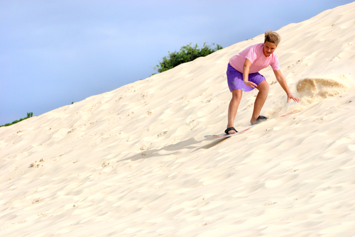 Sandboard the dunes of Genipabu Beach