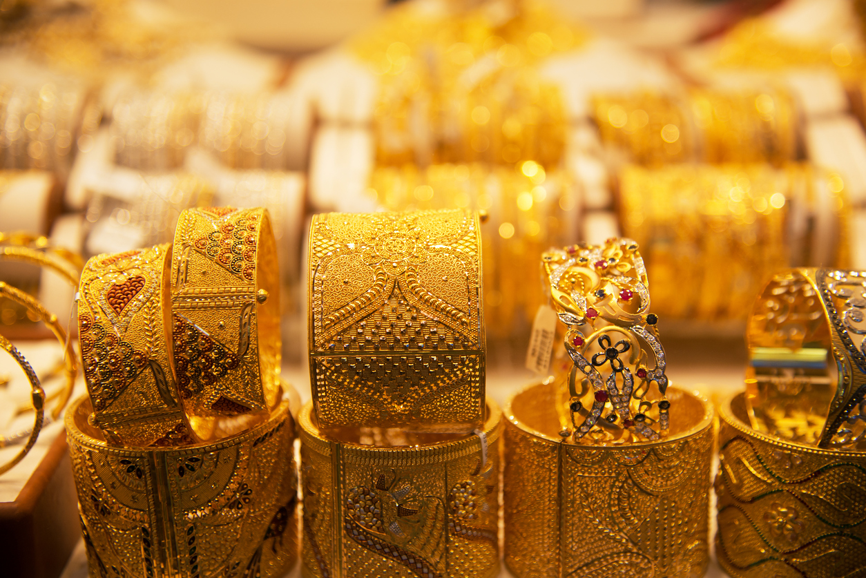 Gold bracelets in a store window in Deira Gold Souq, Dubai, United Arab Emirates (UAE)