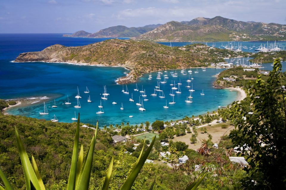 English Harbour, Antigua in the Caribbean is a famous location as a hurricane hole and Nelson's dockyard. Falmouth Harbour is in the background.