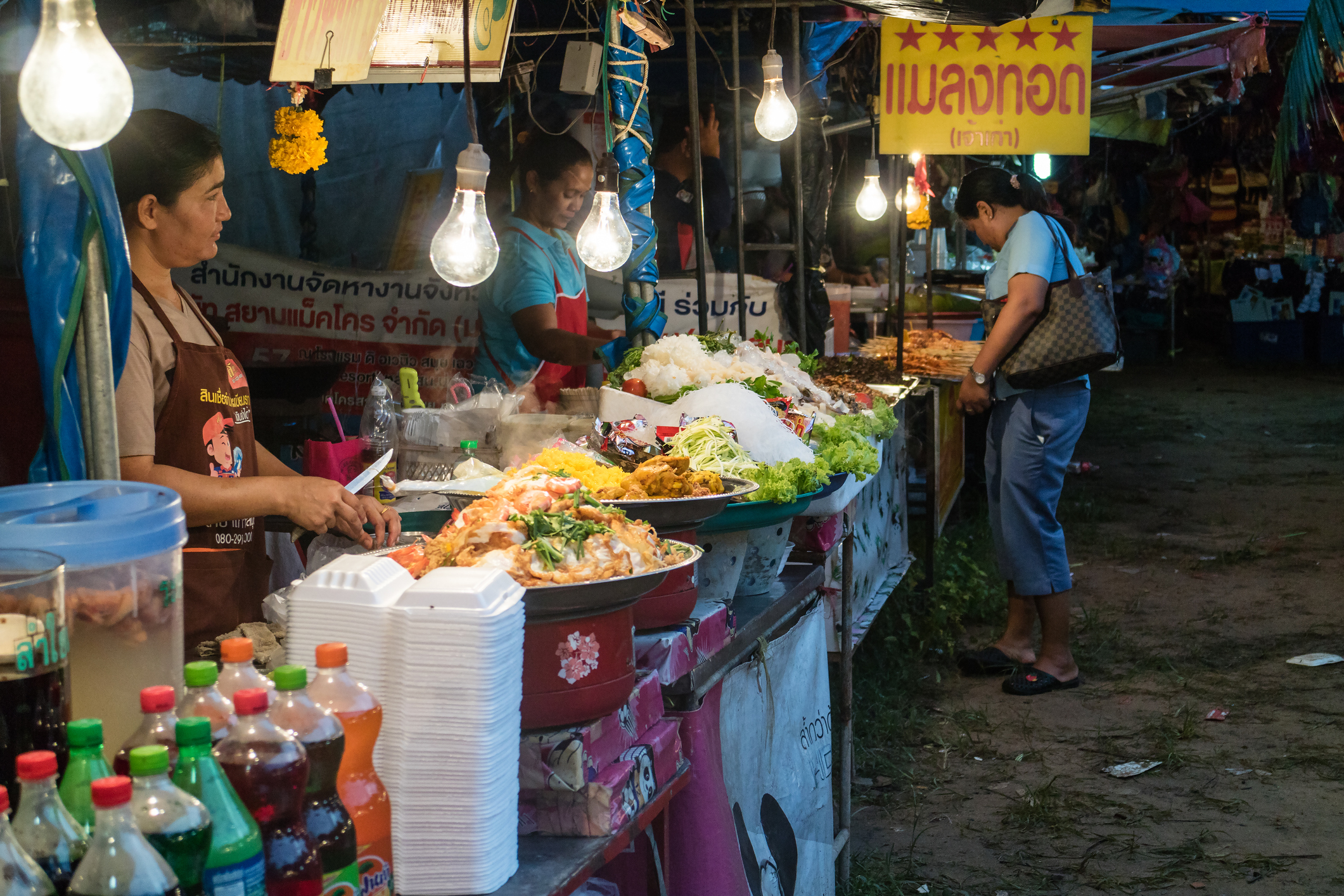 Koh Samui, Thailand - November 30, 2015: Spice saleswomen waiting for clients in an outdoor marketplace