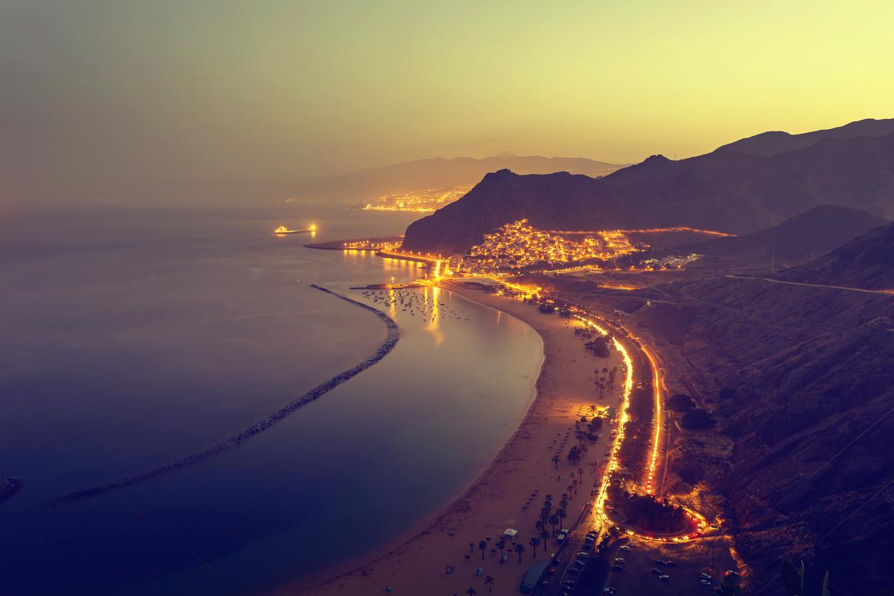 View of Playa de Las Teresitas, Sant Andres and Santa Cruz de Tenerife at dusk..