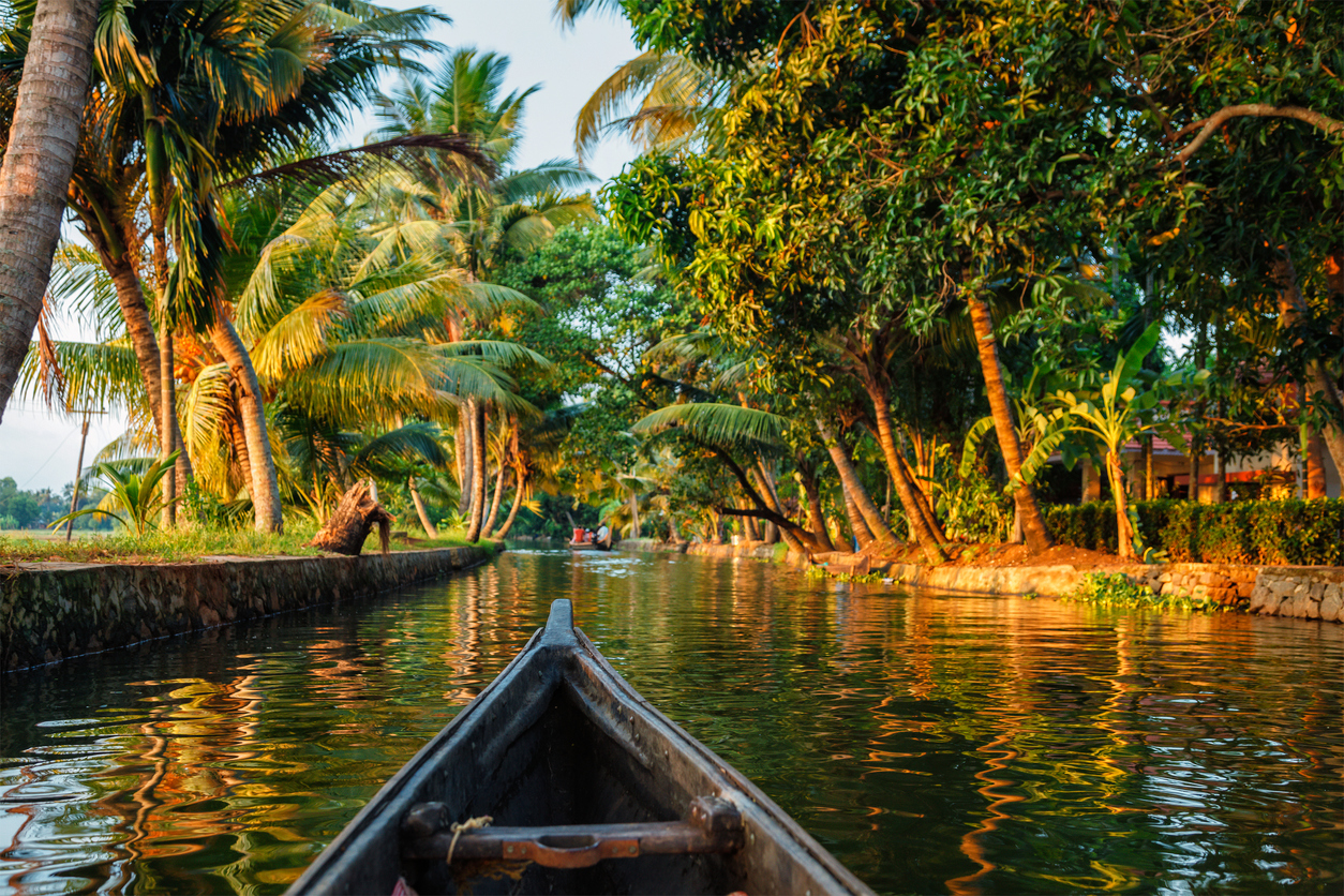 Kerala backwaters tourism travel in canoe. Kerala, India