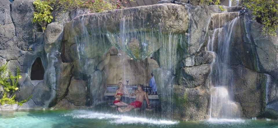 7 seriously awesome swim up bars the travelrepublic blog - Crystal pools waterfall ...