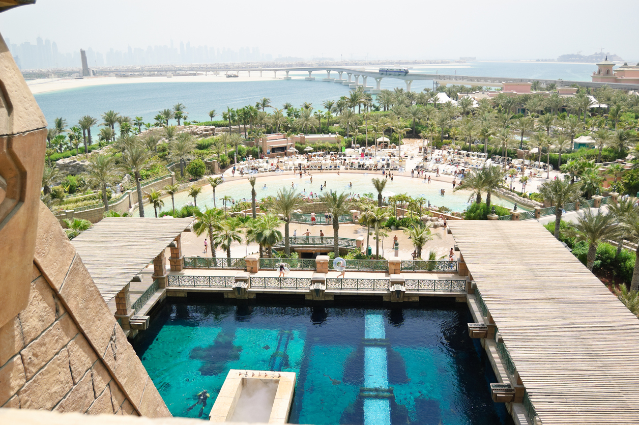 Waterpark of Atlantis the Palm hotel, aquarium with underwater water-sliding chanels and sea fishes, Dubai, UAE